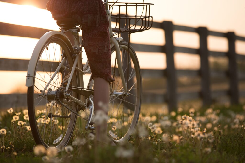 person-riding-bicycle-near-fence-1548771